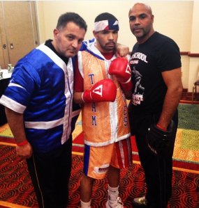 Nieves with trainers Joe Delguyd (L) and Francis Figueroa (R)