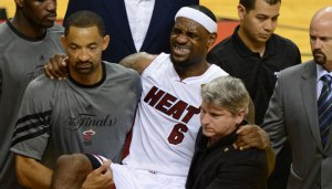 lebron-james-carried-off-court-leg-cramp-nba-finals